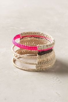 A hot bolt of highlighter pink flashes around this otherwise neutral, hemp and bamboo bracelet. Handmade in Rwanda by Bluma Project, which supports women's employment in cooperatives throughout the world.
