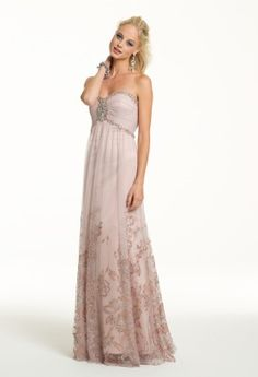 This A-line Cachet evening dress is bordered with glitter and floral appliqued tulle. The beaded empire waist is a sweet touch that enhances your figure and allows the full skirt too create a long leg-line for a beauteous stature.