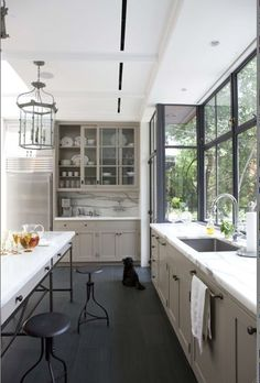 my favorite contemporary kitchen of all-time!!  Aren't those windows great?!