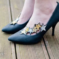Star Shoe Clips - Asymetrical glitter clips to pretty up any footwear. $24.00, via Etsy.
