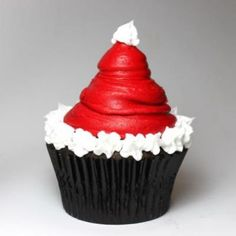 Santa Hat Cupcake. I'll use the HIGH HAT CUPCAKE recipe, dipping in red choc for hat, pipe edges with the marshmallow fluff