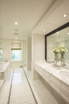 A sense of freshness and elegance. I love the touch of black around the mirror. Meredith Heron design. - interiors-designed.com