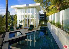 Actor Brendan Fraser's former Beverly Hills home now asks $4.25 million.   http://www.estately.com/listings/info/9400-readcrest-drive--7