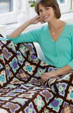 I wish I knew how to crochet. For those of you who do: Spectrum, free pattern at Red Heart.