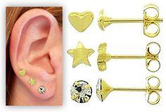 Conjunto c/ três pares de brinco folheados a ouro: pedrinha, estrela e coração