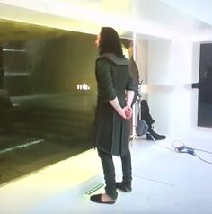 Loki in slippers...WHERE DID THIS PHOTO COME FROM? ummm....Loki...your British is showing!