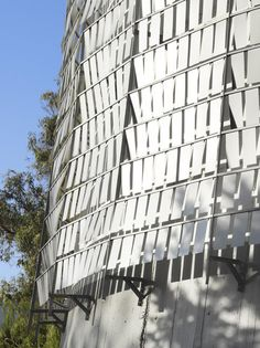 """Water Tower, Chile by architect Mathias Klotz. The exterior metal panels ripple like a pond disturbed by gentle winds.  """"The idea was to produce a skin whose surface was altered by the wind so as to resemble the appearance of the surface of the water when the wind is changed,"""" explained the studio."""