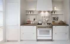 Clean and modern all white kitchen - cabinetry from SieMatic's City Country line.