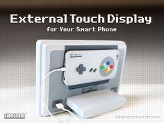 https://www.kickstarter.com/projects/1757082952/libercom-external-touch-display-for-your-smart-pho
