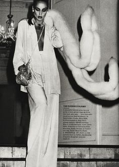 Jerry Hall wearing a white pajama silk pantsuit with white fur shrug - fabulous!