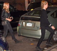 Leading the way: CaraDelevingne was not hanging about as they crossed the road...