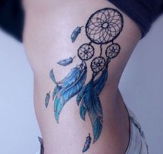 Dreamcatcher rib tattoo