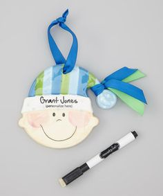 Give little darlings their very own ornament with this merry piece. Easy to hang with the ribbon loop, it also comes with a pen for self-inscribed personalization.