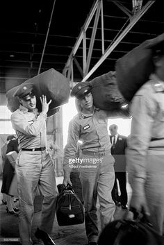 Alfred Wertheimer/Getty Images) At the New York Port of Embarkation's Brooklyn Army Terminal , American musician Elvis Presley carries his bag as he prepares to ship out, New York, New York, September 22, 1958.