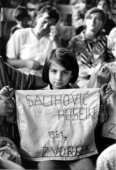 War in the Balkans in the 1990s displaced 3 million people and 8,000 men and boys from the Bosnian Muslim enclave of Srebrenica were executed. Women and children mourn the deaths of their menfolk one year after the fall of Srebrenica. © UNHCR/26211/1996/H.J.Davies