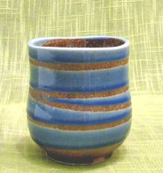 A beautifully hand made tea cup with a swirl pattern in two shades of blue. A nice tactile feel with a strong contrast of rough ceramic and a smooth glaze.
