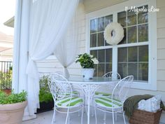 "Green & White Striped Seat Cushions and DIY ""screened porch"" from sheer tie backs--great patio/porch ideas for spring"
