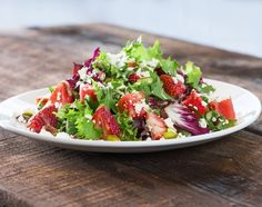 California Fields Salad - Fresh watermelon, strawberries and field greens with housemade Champagne vinaigrette, Feta and California pistachios! [Seasonal Feature] | cpk.com