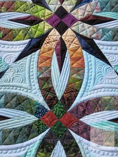close up, Bali Wedding Star quilt, quilted by Rose City Quilter. Pattern by Judy Niemeyer.