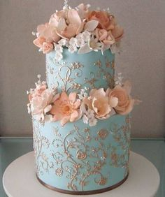 Gold details on sky blue cake with coral florals