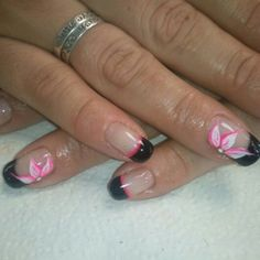 Black shellac tips on the natural nail with white and pink flower