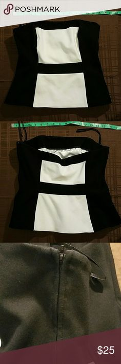 WHBM Colorblock Bustier size 6 Fits true to size, fits 32DD, 32D, 34DD, 34D, 34C very well. Hits hip length. Has moderately rigid boning to help keep it in place. Side zip closure. Great condition, worn only a few times! White House Black Market Tops Blouses