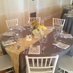 Gray and yellow table setting for a September wedding in our ballroom!
