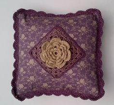 Floral crochet cushion