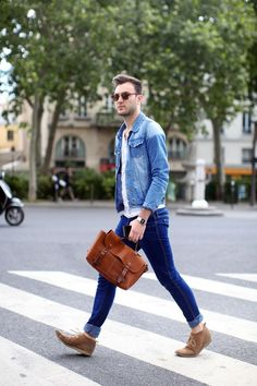 Shop this look on Lookastic:  http://lookastic.com/men/looks/denim-jacket-crew-neck-t-shirt-jeans-messenger-bag-desert-boots/1412  — Light Blue Denim Jacket  — White Crew-neck T-shirt  — Navy Jeans  — Brown Leather Messenger Bag  — Tan Suede Desert Boots