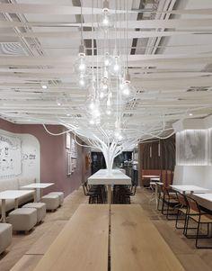 Ippolito Fleitz Group installs metal trees in natural foods restaurant