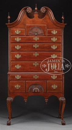Circa 1775. Colchester Area, Connecticut. This highboy compares most favorably in design, cabinetwork and carving to all examples from the Connecticut Valley. It is a testament to mastery of innovation and familiarity with the work of shop traditions in New England and beyond, created of native cherry. The proportions and overall unity are enhanced by superior drawer organization and highly developed carvings. All of which contribute to this highboy's claim to the height of Connecticut s...
