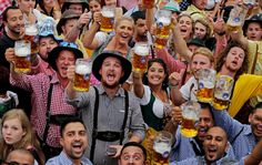 People celebrate the opening of the 181st Oktoberfest beer festival in Munich, southern Germany, Saturday, Sept. 20, 2014. The world's largest beer festival is being held from Sept. 20 to Oct. 5, 2014.