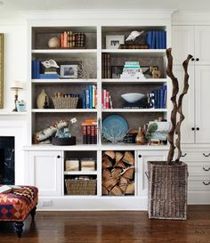 great idea in lieu of wallpaper commitment-Fabric-covered foam-core boards set at the back of shelves create a decorative backdrop. Bookshelf Styling, Bookcase Shelves, Built In Bookcase, Bookcases, Bookshelf Decorating, Fireplace Bookcase, Bookshelf Organization, Bookshelf Design, Fireplace Remodel