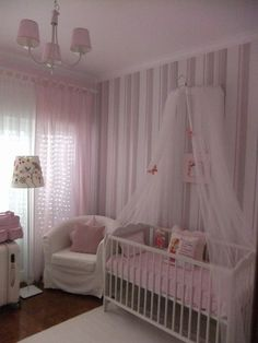 Tulle curtain draping the crib