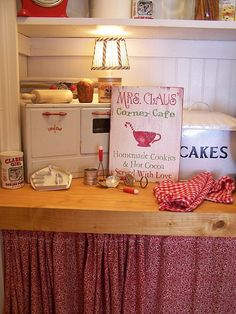 I love the little stove (from Farmhouse Country Style)