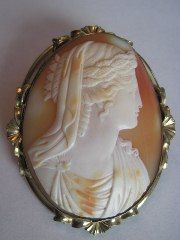 Horned Helmut shell cameo    This cameo features the image of the nymph Daphne who was the Greek god Apollo's first love. The cameo is c. 1850/60 and is set in a very nice pinchbeck frame.