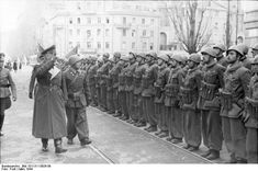 "German General Richard Heidrich inspecting Italian troops, March 1944. By that time, Mussolini had been deposed, arrested, and then freed by the Germans. Italy was at war with Germany and only Mussolini's puppet regime of the ""Italian Social Republic"" still fought on the side of Germany. Roughly a year after this photo was taken, Mussolini was caught and murdered by leftist guerrillas."