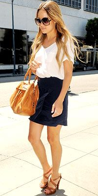 Lauren Conrad paired a David Lerner T-shirt with a 3.1 Phillip Lim skirt and carried a Marc by Marc Jacobs bag.