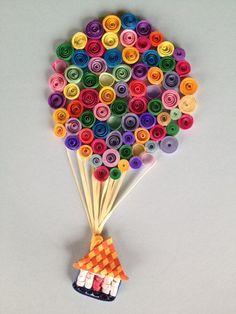 Con rollitos de papel de varios colores podemos darle forma a un impresionante globo ,  una manualidad que puedes adaptar para cualquier tipo de tarjetas de felicitación