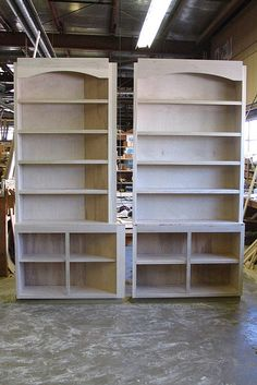 Built-In Bookcases... note extended top rail/curved piece... allows for nailing surface for moldings.