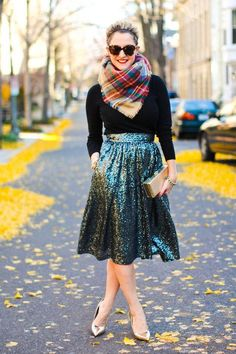 Wear a sequin midi skirt with a long-sleeve black top, and for extra warmth, add a plaid scarf. Click for more holiday party outfit ideas!