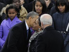 President Obama kisses Myrlie Evers before she gives the invocation during the presidential inauguration ceremony on Jan. 21 at the Capitol in Washington. H. Darr Beiser, USA TODAY