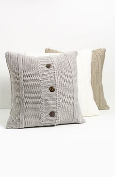 Sweater Pillows (You could use holey or unusable sweaters as soft or fashionable pillowcases instead of throwing them out!)