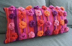 Fabby crochet cushion with crocheted flowers - I love this! Fantastic bright colours too - purple, pink, orange and lilac. Looks great on grey settee.