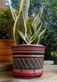 Katie Loves …giving a flimsy plastic pot a 180 degree makeover by poking holes into the cheap plastic and weaving in leftover yarn. Photo: Infinity Blend