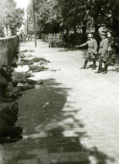 Wehrmacht troops conducting execution of Serbian civilians as a reprisal for 2 murdered German soldiers in the town of Pančevo 21st April 1941. [1024x1411]