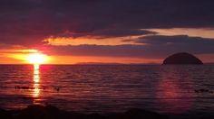 Sun setting over Ailsa Craig Curling Stone, Scottish Gaelic, West Coast Scotland, Paving Stones, Sea Birds, 16th Century, Dusk, Acre, Catholic