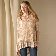 """LACECAPADES TOP--Lace adds instant luxe to everything, from your favorite jeans to slouchy pants or a pair of leggings. This easy pullover in puckered lace, traced all around with a filmy band of tulle, is a dream to wear, lounging at home or out on the town. Wide bateau neck, elbow sleeves, hi-lo hem. Nylon, rayon, spandex. Dry clean. USA. Sizes S (4 to 6), M (8 to 10), L (12 to 14). Front approx. 24""""L."""