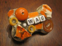 WAG mosaic dog broach mosaic art.
