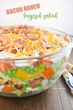 Summer salads don't get any better than this Bacon Ranch Layered Salad. Beautiful layers of veggies, bacon, ranch dressing and cheese.